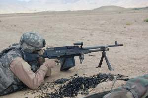 AF Lt shooting M-240 machine gun supported by bipod