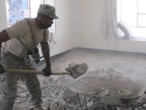 AF MSgt shoveling broken concrete