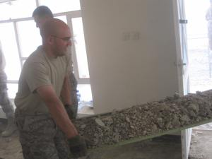 AF SSgt carries out debris