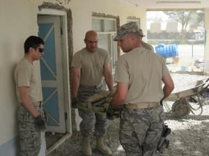 AF team members removing broken concrete