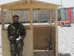 MSG Abdullah in front of unfinished guard shack