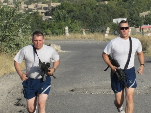 Af Capt and Lt run up the hill with their weapons