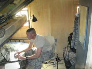 AF TSgt in his cubicle