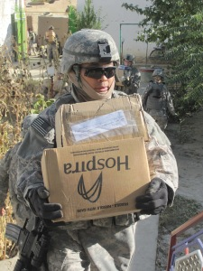 AF MSgt carrying medical supplies.