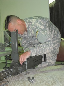 AF SSgt checks head spacing and timing on M2 machine gun