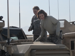 AF lady-power checking out MRAP engine.