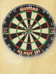 Camp dartboard is finally hung on wall.